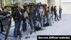 Jurnaliști la o conferință de presă