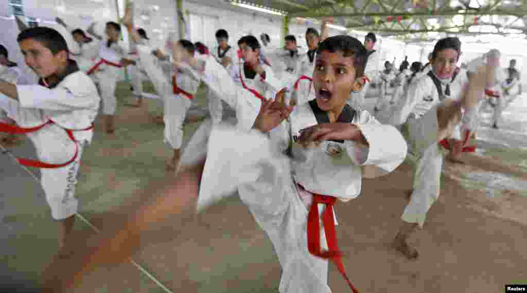 Syrian refugee children undergo training in the Korean Taekwondo Academy For Syrian Children at the Al-Zaatari refugee camp in the Jordanian city of Mafraq, near the border with Syria, on March 24. (Reuters/Muhammad Hamed)