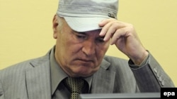 Former Bosnian Serb General Ratko Mladic sits in the courtroom during his initial appearance at the UN's Yugoslav war crimes tribunal in The Hague in June 2011.