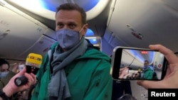 Aleksei Navalny on board a plane in Berlin before his departure for Moscow on January 17