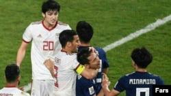 Iranian striker, Ehsan Haj safi, clashes with Japan football player, January 28, 2019.