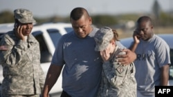 Soldiers at Fort Hood confront the news of the shootings at the base.