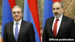 Armenian Prime Minister Nikol Pashinian (right) and then-Foreign Minister Zohrab Mnatsakanian attend an event in Yerevan in March 2019.
