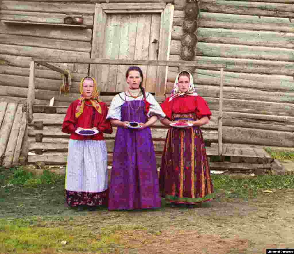 Young Russian women offer berries to visitors outside their izba, a traditional wooden house, near the Sheksna River. - Photos and caption information courtesy of the Library of Congress.
