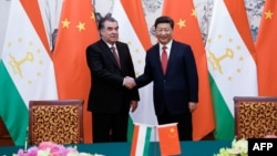 Chinese President Xi Jinping (right) shakes hands with Tajik President Emomali Rahmon in Beijing in September 2015.