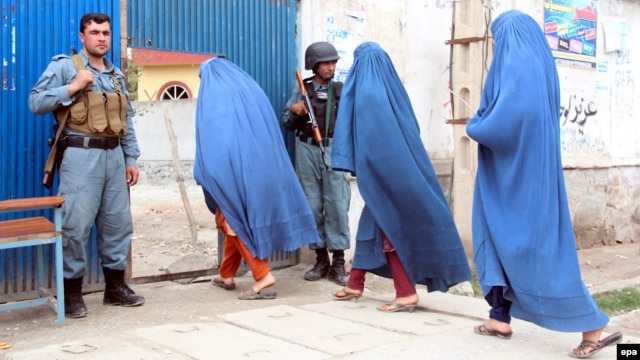 Afghan women arrive to cast ballots at a polling station in Jalalabad, Afghanistan, on April 5.