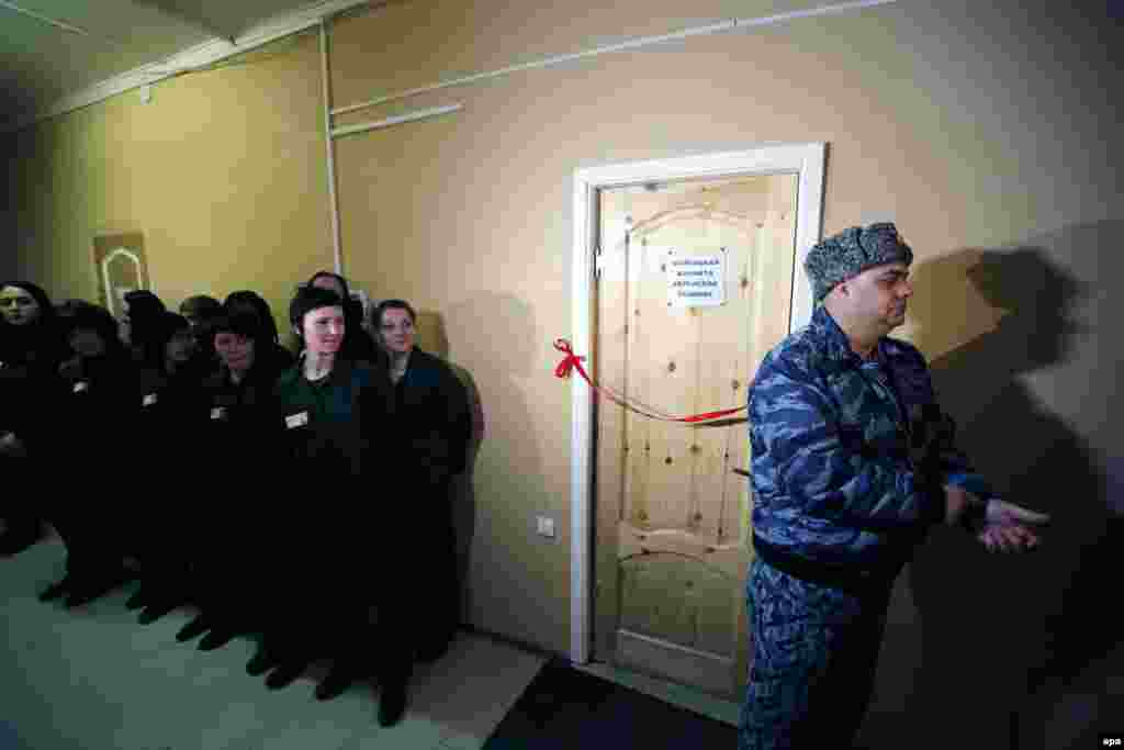Jewish prisoners and prison officials attend the opening ceremony of a female Jewish prayer room at correctional colony N2 in Ulyanovka, about 40 kilometers from St. Petersburg, Russia. It will be the first prayer room opened for convicted Jewish women in Russia. (epa/Anatoly Maltsev)