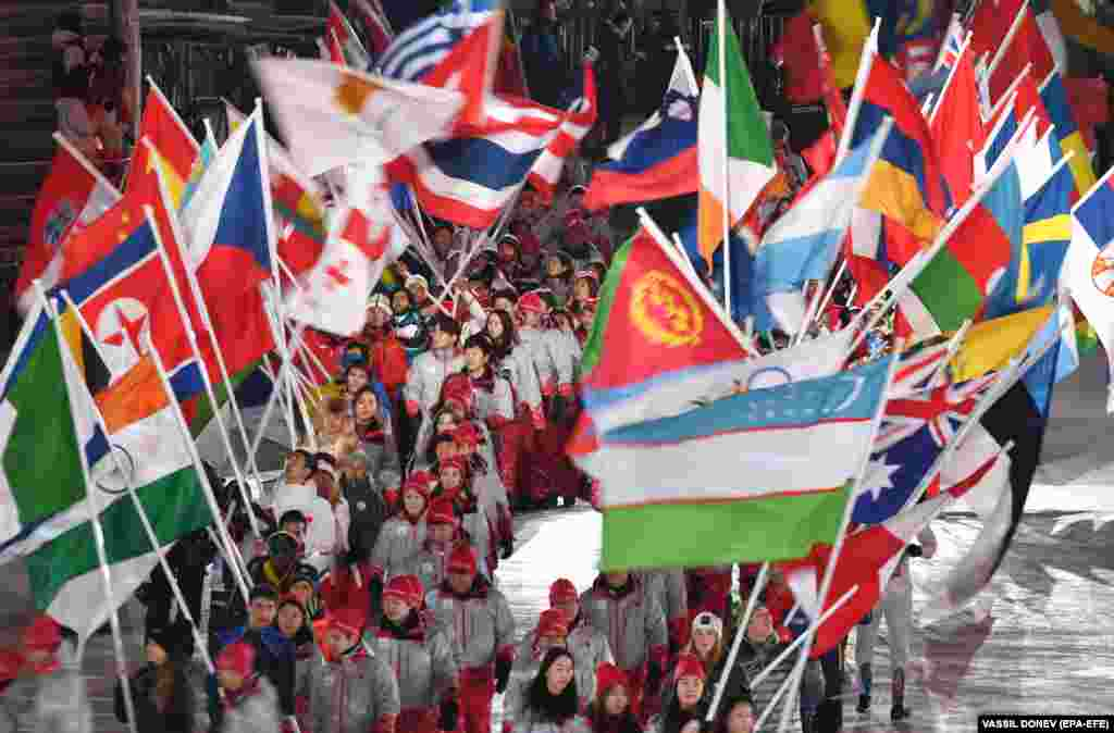 Closing Ceremony: Volunteers walk in with Olympic nation flags for the Closing Ceremony of the PyeongChang 2018 Olympic Games, Pyeongchang county, South Korea, 25 February 2018. (EPA-EFE/VASSIL DONEV)