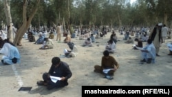 Afghan students take an entrance exam for a Laghman Province technical school. Access to higher education is extremely limited in Afghanistan.