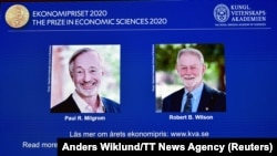 SWEDEN -- Pictures of the winners of the 2020 Nobel prize in economic sciences, Paul R. Milgrom and Robert B. Wilson, are displayed on a screen at a news conference in Stockholm, October 12, 2020