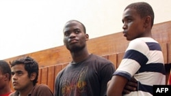 Michael Adebolajo (center) is seen in a 2010 photo that shows him in Kenyan custody.