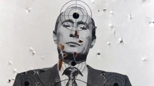 Мішень у вигляді портрету президента Росії Володимира Путіна на  в стрільбищі у Львові, 31 серпня 2014 року