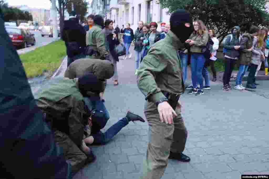 Many protesters were forced to the ground and restrained by police.