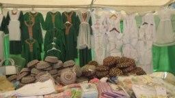 Turkmenistan. School market in Ashgabat. Shoes, bags, dresses, hats. August 2018