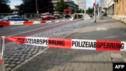 A police line is seen near the site where a Syrian asylum seeker killed a woman and injured two people with a machete in Reutlingen, southern Germany, on July 24.
