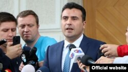 "Prime Minister-designate Zoran Zaev said his 26-member cabinet would be committed to ""the economy, strong public institutions and [future membership of] the European Union and NATO."""