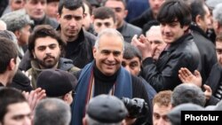 Opposition leader Raffi Hovannisian is greeted by supporters in Yerevan's Liberty Square on February 22