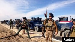 Iraqi security forces during clashes with Al Qaeda-linked militants in the city of Ramadi, 100 kilometers west of Baghdad, February 2.