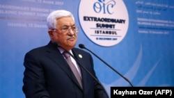 Palestinian leader Mahmud Abbas calls for the United Nations to replace the United States as Middle East mediator.