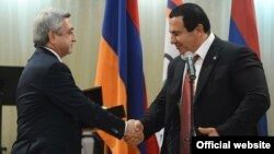 Armenia - President Serzh Sarkisian (L) and Prosperous Armenia Party leader Gagik Tsarukian shake hands during an award ceremony at the National Olympic Committee, Yerevan,26Dec,2012.
