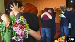 A screen grab from Iranian state Press TV shows the first tearful reunion of the mothers with detained Americans Josh Fattal, Sarah Shourd, and Shane Bauer (left to right) in Tehran on May 20.