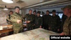 Ukrainian President Petro Poroshenko (left) visits the restive Donbas region on June 20