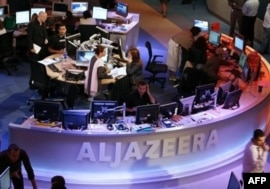 Al-Jazeera said its employees were not working with the Taliban.