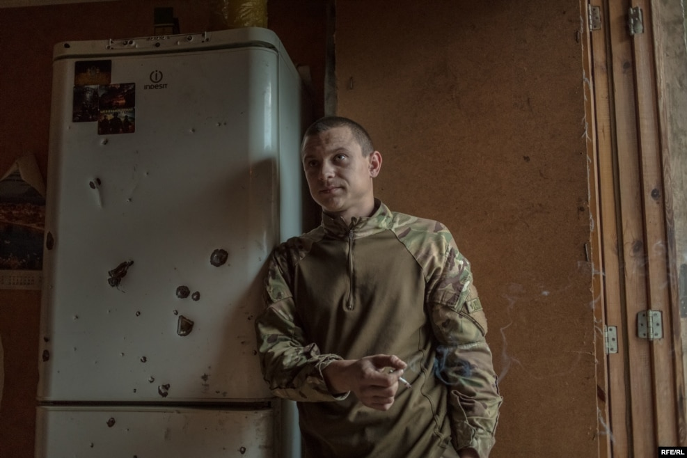 "Posing next to a bullet-riddled fridge, this is ""Chikatilo"" -- nicknamed after a Soviet-era serial killer. Before the war, he was a taxi driver."