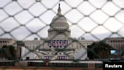 The U.S. Capitol building is seen behind a security fence in Washington on January 19.