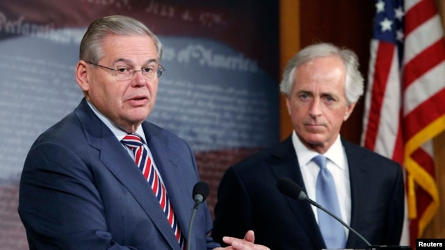 U.S. -- U.S. Senate Foreign Relations Committee Chairman Robert Menendez (D-NJ) (L) and ranking member Senator Bob Corker (R-TN) (R) hold a news conference after a Senate vote on an aid package for Ukraine at the U.S. Capitol in Washington March 27, 2014.
