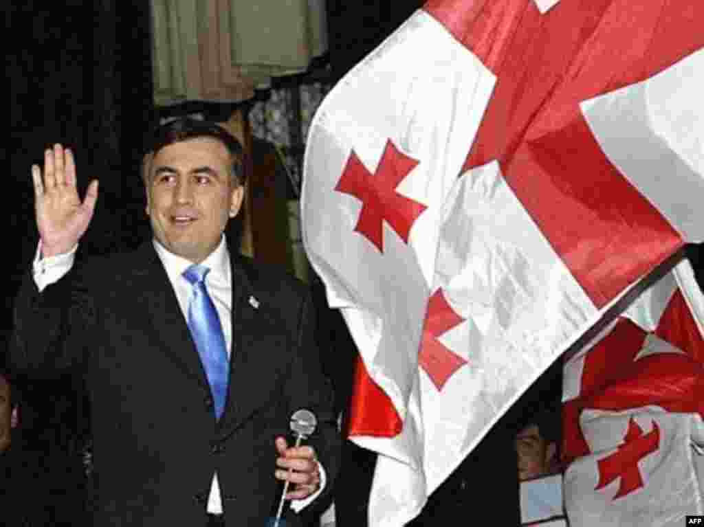 Mikheil Saakashvili waves to supporters in Tbilisi early on election day.