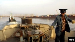 A barge operator on the Amu Darya river near the Uzbek border town of Termez