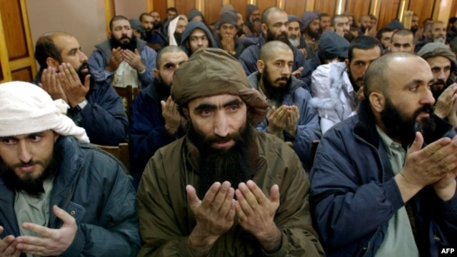 While some U.S. detainees, such as these in 2005, have been turned over to the Afghan authorities, some 600 remain in custody at the Bagram detention center.
