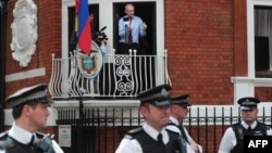 WikiLeaks founder Julian Assange addresses reporters and supporters from a balcony of Ecuador's embassy in London on August 19.