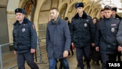 Russian opposition leader and anticorruption blogger Aleksei Navalny is detained by police in a Moscow subway station on February 15.