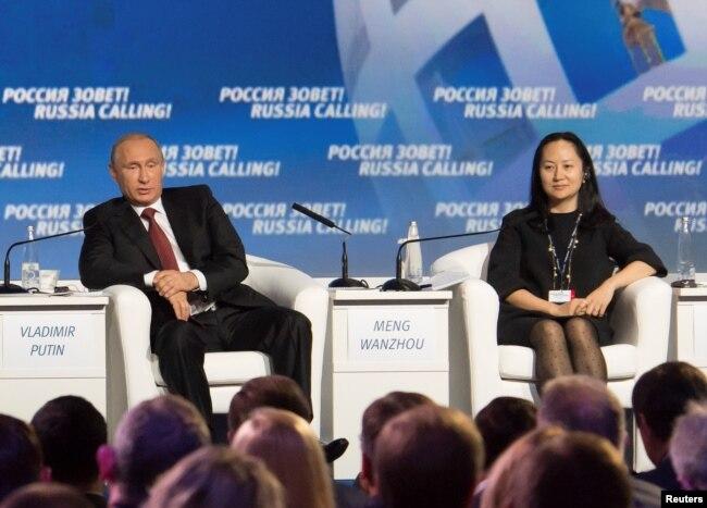 Владимир Путин и арестованная в Канаде Мэн Ваньчжоу