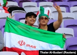 Iranian fans pose before the 2019 AFC Asian Cup semifinal match between Japan and Iran in the United Arab Emirates in January.