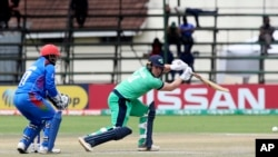 Ireland batsman Gary Wilson, right, plays a shot during their Cricket World Cup qualifier match against Afghanistan at Harare Sports Club on March 23.