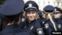 Police officers wait before an oath-taking ceremony in Kyiv on July 4.