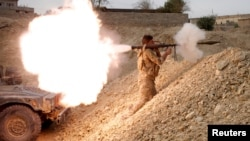 An Iraqi soldier fires a rocket-propelled grenade south of Mosul on November 10.