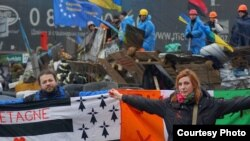Dimitri Halby and his wife, Oksana, are helping to coordinate global protests against the sale of Mistral warships to Russia. They are shown here participating in Euromaidan protests in Kyiv in February.