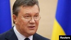 Віктор Янукович під час попередньої появи на публіці, Ростов-на-Дону, 11 березня 2014 року