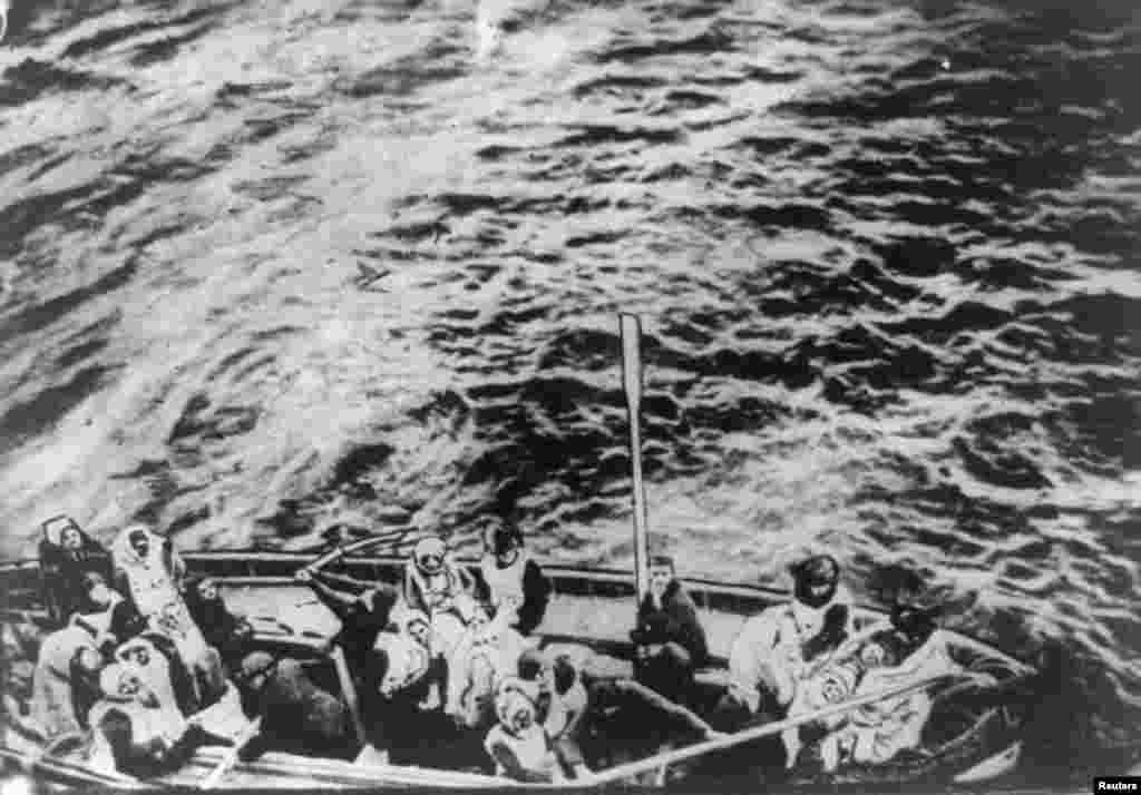 "A lifeboat from the ""Titanic"" pulls alongside the ""Carpathia"" following the sinking on April 15, 1912."