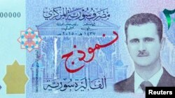 A portrait of Syria's President Bashar al-Assad is seen on the new Syrian 2,000-pound banknote.