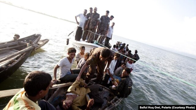 The refugees fleeing Burma are apprehended by Bangladeshi border guards.