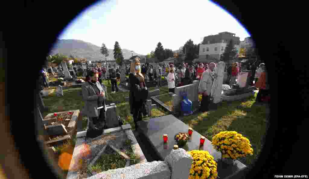 People attend Mass at St. Joseph cemetery in Sarajevo.