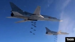 Russian Tupolev Tu-22M3 strategic bombers drop bombs at an unknown location in Syria in 2015.