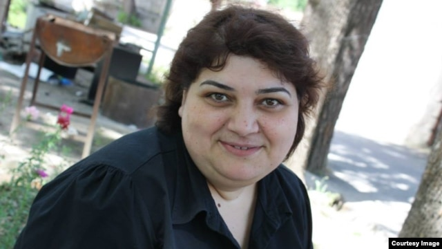 "Khadija Ismayilova denounced the charges of libel, tax evasion, illegal business activity, and abuse of power as a ""scam"" aimed at silencing her investigative reporting."