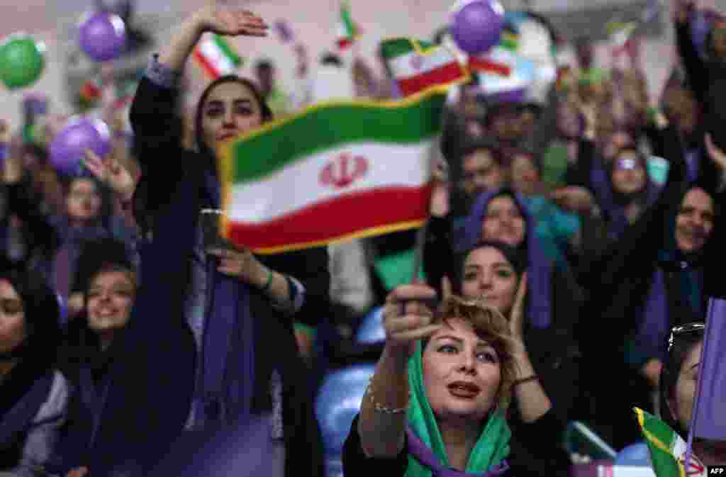 Supporters of Iranian president and presidential candidate Hassan Rohani chant slogans during an election-campaign rally in the northwestern city of Zanjan on May 16. (AFP/Behrouz Mehri)