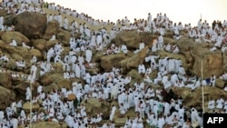 Muslim pilgrims arrive to pray at Mount Arafat today.